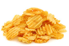 Freshly baked deep ridged potato chips. On a white background Stock Images