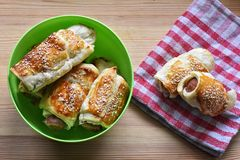 Freshly baked delicious homemade hot dogs in sesame bun/ closeup still life food photography Stock Photography