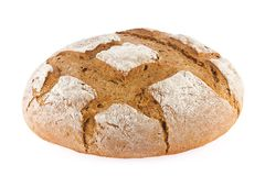Freshly baked domestic rye bread with bran. Royalty Free Stock Photography