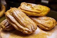 Freshly baked eclairs Stock Photo