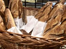 Freshly baked French baguette in a basket on the table royalty free stock photography