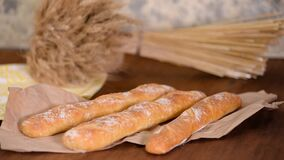 Freshly baked French baguettes on wooden table.