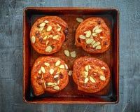 Freshly baked French raisin buns. Pains aux raisins on a vintage baking tray.  Royalty Free Stock Photos