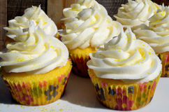 Freshly baked frosted lemon cupcakes Royalty Free Stock Image