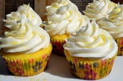 Freshly baked frosted lemon cupcakes. Hot Fresh baked frosted lemon cupcakes Royalty Free Stock Image