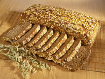 Freshly baked full grain bread on table Royalty Free Stock Images