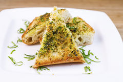 Freshly Baked Garlic Bread with herbs and butter Royalty Free Stock Photography