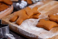 Freshly baked gingerbread on the table with flour, close up. Tra stock photo