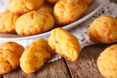Freshly baked gougere buns with cheese close-up. Horizontal Stock Photography