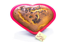 Freshly baked heart-shaped Valentines cake Stock Photography