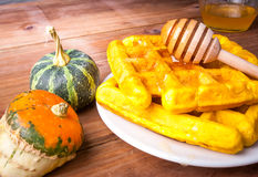 Freshly baked homemade Belgian waffles with pumpkin stock images