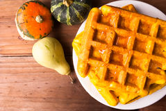Freshly baked homemade Belgian waffles with pumpkin stock photo
