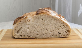 Freshly baked homemade bread dusted with flour Royalty Free Stock Photos