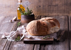 Freshly baked homemade bread on wooden cutting board Royalty Free Stock Photography
