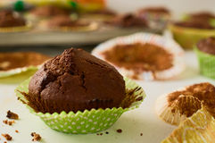 Freshly baked homemade chocolate muffin cupcake in green paper c. Concept of comfort food. Freshly baked homemade chocolate muffin cupcake in green paper cup Royalty Free Stock Photos