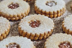 Freshly baked homemade Christmas sugar cookies with jam. Close up of freshly baked homemade Christmas sugar cookies with jam stock photo