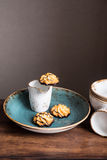 Freshly baked homemade coconut macaroons glazed with dark chocolate Stock Images