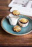 Freshly baked homemade coconut macaroons glazed with dark chocolate Royalty Free Stock Photos