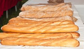 Freshly baked, homemade french bread for sale at a local farmers market stock images