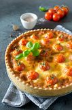 Freshly baked homemade pie quiche Lorraine on a concrete backgro. Und. Traditional French pastries Stock Image
