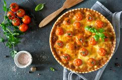 Freshly baked homemade pie quiche Lorraine on a concrete backgro. Und. Traditional French pastries Royalty Free Stock Images