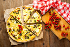 Freshly baked homemade pie quiche lorraine. On a wooden table Stock Image
