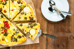 Freshly baked homemade pie quiche lorraine. On a wooden table, top view, copy space Stock Image