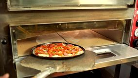 Freshly baked homemade pizza in electric oven stock video