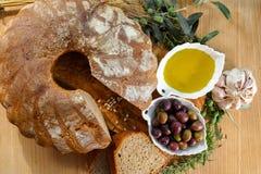 Freshly baked homemade sourdough spelt bread, extra virgin olive Royalty Free Stock Images