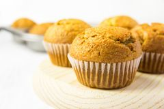 Freshly Baked Homemade Whole Wheat Bran Carrot Pumpkin Muffins on Wooden Board. Breakfast Morning Sunlight. Healthy Pastry Baking royalty free stock images