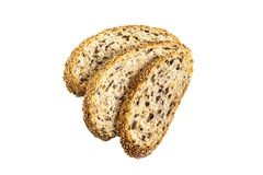 Slices of whole wheat bread with flaxseeds on white background royalty free stock images
