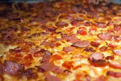 Freshly Baked and Hot Pizza Removed From an Oven royalty free stock images