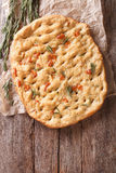 Freshly baked Italian focaccia with rosemary and cheese. Vertica Royalty Free Stock Images