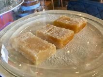 Freshly Baked Lemon Bars. Dessert bars, or simply bars or squares, are a type of American & x22;bar cookie& x22; that has the texture of a firm cake or softer royalty free stock image