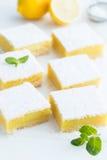 Freshly baked lemon bars. Or lemon  squares with powdered sugar on white bakground, selective focus Stock Photo