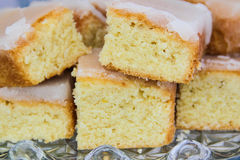 Freshly baked lemon cake. Freshly baked lemon drizzle cake stock photography