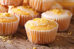 Freshly baked lemon muffins with frosting macro. horizontal Royalty Free Stock Photos
