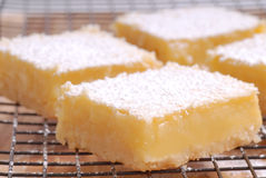 Freshly baked lemon squares cooling on wire rack Royalty Free Stock Photo