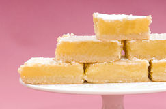 Freshly baked lemon squares on a white cake stand Stock Images