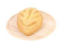 Freshly baked loaf of cornbread on platter. Stock Photo
