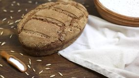 Freshly baked loaf of homemade organic sourdough rye bread on wooden table stock footage