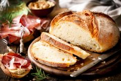 Homemade rustic bread loaf with ham Royalty Free Stock Photography