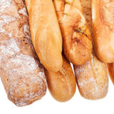Freshly baked loaves of bread. Isolated on white background stock image