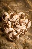 Freshly baked meringues on baking paper Royalty Free Stock Images