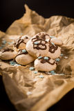 Freshly baked meringues on baking paper Stock Images