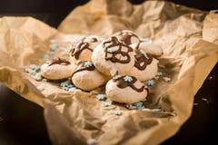 Freshly baked meringues on baking paper Stock Image