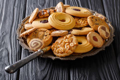 Freshly baked mix of biscuits close-up on a plate. horizontal Stock Image