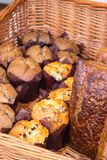 Freshly baked muffins and breads in basket Royalty Free Stock Photography