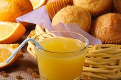 Freshly baked muffins with orange juice macro, horizontal Stock Photos