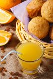 Freshly baked muffins with orange juice vertical top view Royalty Free Stock Image